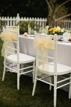 Yellow & grey country chic  Photography: Jamie Delaine // Event Designer:  6Pence Wedding Planning & Design // Floral Designer:  Greenstems  Love the organza chair sashes on the white chiavari chairs!  Find organza chair bows in 30 wonderful colors and just $1.65 each!  Order 100 and we will ship them to you for free at www.event-warehouse.com