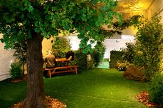 The faux pop-up park Park Here explores the meaning of indoor greenspaces. Indoor Dog Park, Artificial Tree, Indoor Outdoor, Outdoor Decor, Indian Home Decor, Atrium, Room Themes, Resorts, Home And Garden