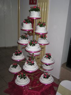 Quinceanera Cake tower - a traditional part of the Quinceanera celebration - read more at our blog
