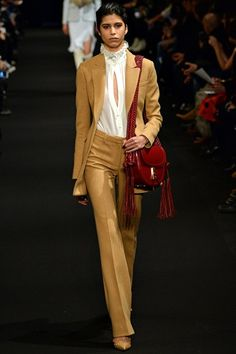 Seventies Endures AltuzarraThe decade's not going anywhere. The heady days of the Seventies are still capturing our imaginations. See the fringing at Edun and slinky flares at Narciso Rodriguez, kicky wide leg cuts cart-horsed down the runways watched by editors already wearing them