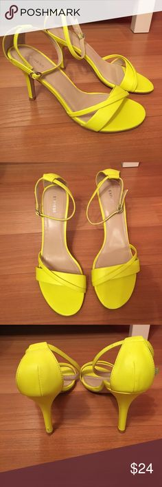 Neon Yellow Ankle Strap Heels Super cute neon yellow ankle strap heels. These shoes were worn once, still have a lot of life left in them. The ankle strap helps to keep ankle in place when worn. Synthetic upper. Express Shoes Heels