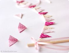 Bunting cake topper diy tutorial from HotPolkaDot.com, includes free PDF of printable flags