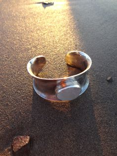 custom made etched silver cuff with moonstone that was found on the beach in Westport, Wasington state