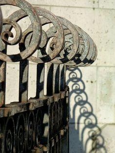 Curls + shadows by bbonthebrink, via Flickr. Sacré Coeur in Montmartre