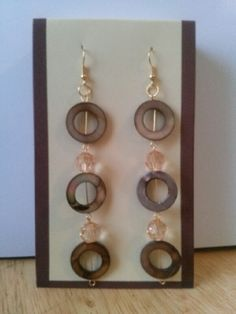 Brown washer and clear acrylic bead earrings.