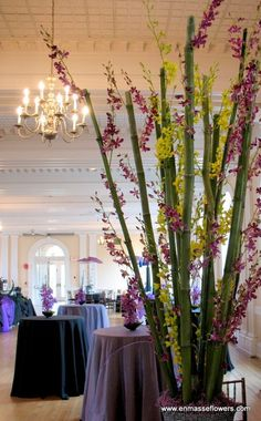oh wow maybe same thing bamboo with lilies, lavender, lilacs, and orchids climbing throughtout Green Orchid, Purple Orchids, Flower Decorations, Wedding Decorations, Wedding Ideas, Orchid Centerpieces, Artificial Orchids, Marriage Decoration, Bamboo Crafts