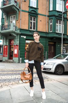 30 Street Style Looks That Will Break You Out of Your Winter Fashion Rut  Collegiate Classics Note the half-tuck and the I'm-wearing-invisible-heels pose. Very flattering.  Shop this look: Superga 'Acot Linea' Sneaker, $80; LOEWE 'Small Hammock' Leather Hobo, $2,450; Alexander McQueen Wool sweater, $418  A Portable Package