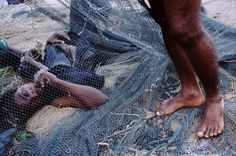 Alex Webb  IVORY COAST. Abidjan. 2004. Ile Boulay. Village scene.