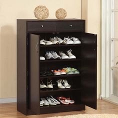 Cabinet with two upper storage bins is both flexible and functional. $159.99 http://www.brookstone.com/five-shelf-shoe-cabinet-with-two-upper-storage-bins
