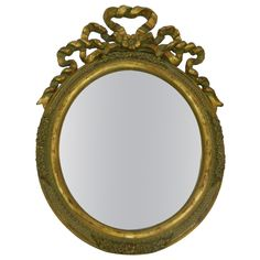 1stdibs.com | Italian Hand Carved Gold Leaf Oval Vanity Mirror with a Ribbon Motif
