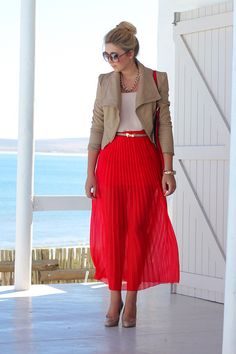Light tan leather jacket, white top, red pleat maxi skirt and nude pumps