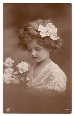 .Little girl w/ white flowers & white bow in hair!  b/w picture.
