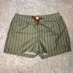 Men's Penguin Swim Shorts! In like-new condition swim bottoms for men! Green is primary color of bottoms. Burnt orange is color of drawstring. Striped with blue and white lines. Size 36 in men's! Any questions at all, just ask! ☺️ Penguin Other