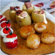 Tábua de pintxos (batata bolinha recheada com queijo cremoso e coberta por bacon e erva doce; tomate recheado com queijo de cabra e orégano fresco)