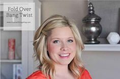 Sweep bangs to the side with an easy twist + two tucked away bobby pins: