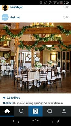 White linen, dark chairs and napiks, ivy and white green florals