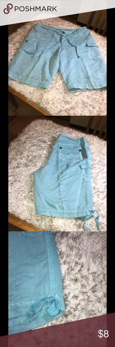 Style & Co Turquoise Casual Shorts Size 16 Shorts by Style & Co.  turquoise color.  Size 16.  Mid thigh length.  Tie accent at waist and leg Cuff.  Has extra pockets.  Great condition.  Important:   All items are freshly laundered as applicable prior to shipping (new items and shoes excluded).  Not all my items are from pet/smoke free homes.  Price is reduced to reflect this!   Thank you for looking! Style & Co Shorts