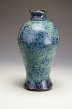 """A Chinese Yixing Meiping by Ge Ming Xiang. 18th/19th century, Qing dynasty. Dark stoneware vase of meiping form with a dark blue mottled flambe glaze. With four character artist's mark, """"Ge Ming Xiang Zhe,"""" stamped to base. Approx. 11 1/4 by 5 1/2 in."""