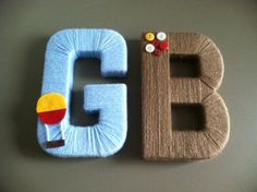 """Yarn wrapped letter """"G"""" and """"B"""" with felt hot air balloon and button embellishments for a little boy's nursery."""