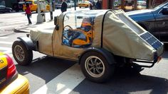 Industrious Manhattan man drives to work in homemade electric vehicles made of old car parts.