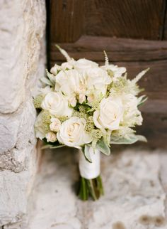 Classic white rose bouquet | Photography: Marisa Holmes - www.marisaholmesblog.com  Read More: http://www.stylemepretty.com/2014/08/04/intimate-destination-wedding-in-tuscany/