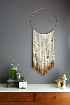 Dip dye yarn to achieve this cool DIY wall hanging.