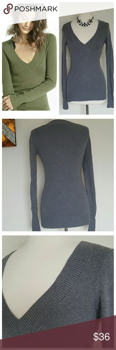 Express Fitted Gray V-Neck Sweater Medium Grey long sleeve sweater by Express. Size medium. Fitted silhouette perfectly working with curves. Light knit with vertical ribbed construction and deep v-neckline. Cotton/Rayon/Nylon. Great condition! Express Sweaters V-Necks