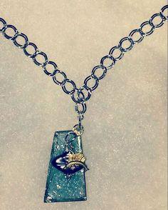 Necklace with antique swordfish metal stamping on dark purple freshwater pearl and blue stained glass #swordfish #sealife #nautical #sea #ocean #metalstamping #stainedglass #freshwaterpearls #necklace #texasgirl #texasmade #madeintexas #texasstyle #dallas #dfwartist #dallasartist #handmadejewelry #customjewelry #ilovetheocean