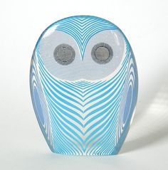 Another blinking eyes owl, enhanced by blue designs.