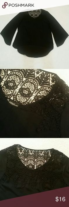 Flowy blouse with lace cutout detail Black flowy 100% polyester blouse with bell sleeves, in perfect condition. Worn once. The details on this are so cute! This is the perfect light long sleeve shirt for fall. Make me an offer! Tops Blouses
