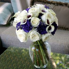 White and Purple Wedding Flowers for Table Decorations