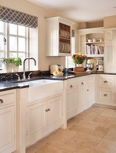 Harvey Jones Original kitchen with bespoke oak plate rack and bookshelf  www.harveyjones.com