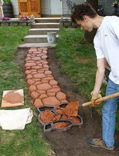 Hate the color, but maybe a good alternative to a poured concrete walkway.