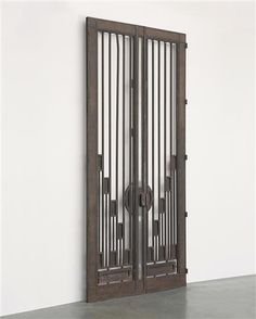 ATTRIBUTED TO JEAN PROUVÉ  Large pair of doors, circa 1930-1939