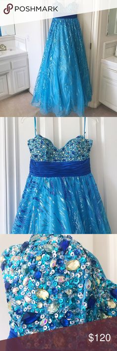 Caché Dress 🦋👗 Homecoming Ball Gown Blue Sz 8 I'll never forget the look on my dad's face when he saw me in this dress for the first time. It was like every dream of becoming a Cinderella princess for senior ball night was finally coming true. 👗 With extensive tulle, rhinestones, sparkles, and sequins, this gown is sure to make you feel like royalty. 👸🏼✨It is strapless and the bodice is encrusted with blue, silver, and gold jewels. Perfect for military ball, gala, prom night…