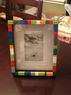 DIY Lego frame. All you need is a frame, glue gun and Lego!! Super easy!