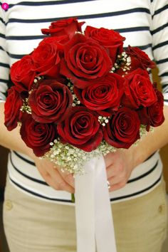 I want this for my bouquet. Red roses with a little bit of babies breath. Pearls wrapped around bottom part of the bouquet?
