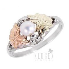 Black Hills Sterling & 12K Gold Ring w Pearl    Material: .925 sterling silver, 12k gold leaves  Gemstones: 4.5mm genuine cultured freshwater pearl  Width in mm: 9.1mm  Width in inch: 3/8-inch  Stamped: 925, 12k