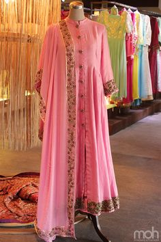 Look pretty in this powder pink chanderi anarkali with zardosi border and an open front that gives it a different look. It comes with a georgette dupatta to add to its beauty! #ethnic #ethnicwear #anarkali #dress #indianfashion #traditionalwear #mohstringsattached