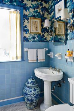 See This New Orleans Ranch's Classic Country Makeover | Determined to keep the original blue tile in the master bath, Smith updated it with two rolls of Raphaël wallpaper #decorideas #homedecor #southernliving