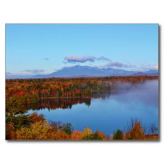 Mt.Katahdin Autumn Scenery Postcard (Pkg of 8) by KJacksonPhotography --  Taken 10.12.2014 Mt. Katahdin, the beautiful blue skies and some clouds contrast wonderfully with surrounding colorful canopy of autumn leaves of the forest - brilliant dazzling reds, oranges and golds. Salmon Stream Lake beautifully reflects the kaleidoscope of colors of this fall's vivid hues. From the I95 scenic turnout, mile marker 252.PC:243.284 #nature #photography #autumn #mtkatahdin #postcard #postcards