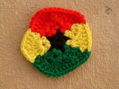 This is awesome! A crochet pentagon inspired by the flag of Ghana: http://www.crochetbug.com/pollen-pollen-everywhere/