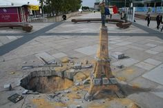 Julian Beever's 3D Pavement Drawings ~ Eiffel Tower Sand Sculpture. This drawing in Paris was the subject of Episode 8 of the Gallery HD television series 'A Concrete Canvas' shown in the USA.