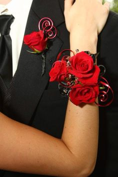 Red corsage and boutonnière