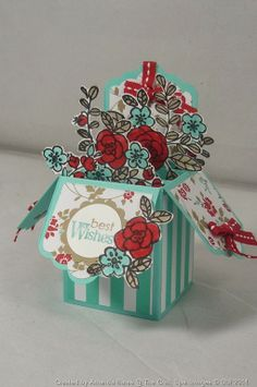 Card in a box...I like how she used the Scalloped Tag Topper punch and also the overhang of flowers