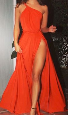 One shoulder gown with thigh slit.