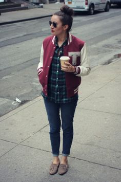 Try a varsity jacket over a plaid shirt and skinny jeans.