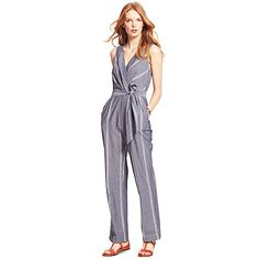Tommy Hilfiger women's jumpsuit. There are so many reasons to love this jumper: The crisscross bodice, the lofty bow, the chic and easy vibe—all dressed up in pinstriped chambray. An editor favorite, indeed. <br/>•Slim fit. <br/>•100% cotton. <br/>•Back zip closure, slash pockets. <br/>•Machine washable.<br/>•Imported.<br/>