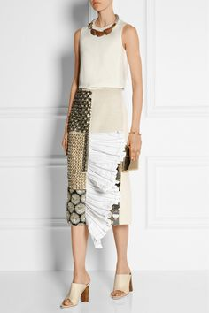 Marni|Embellished paneled canvas midi skirt|EDITORS' NOTES & DETAILS Beige canvas serves as the base for the substantial embellishments on Marni's midi runway skirt. Decorated with panels of beads, crystals and mirrored disks, it has a white poplin ruffled trim. This piece is fully lined with a back vent for ease of movement. Let yours take center stage with a tonal shirt and sandals.