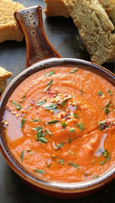 "CREAMY TOMATO  TARRAGON SOUP ~~~ this share also includes a link to a parmesan black pepper biscotti from gourmet magazine that she has chosen to serve with ""her new favorite"" soup. [bakerbynature] [gourmet] [parmigiano-reggiano, parmesan]"